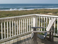 oceanfront deck with adirondack deck chair