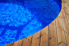 wood deck and round swimming pool